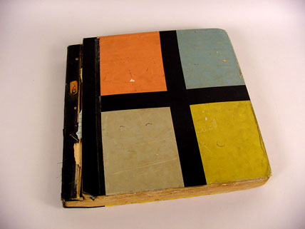Colorful family photo album made from discarded wallpaper sample