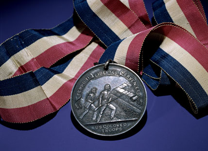 Silver Civil War colored troops medal hung on cotton band