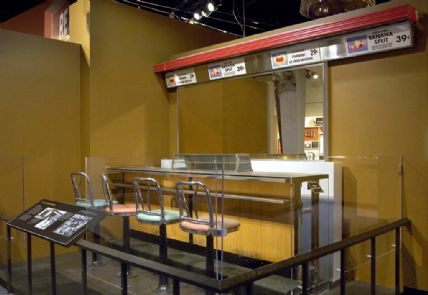 Greensboro Lunch Counter with salmon and sea-foam seats