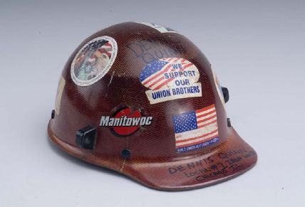 Red iron worker's hat with stickers
