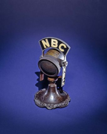 Fireside Chat microphone with yellow NBC letters