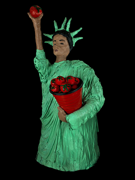 Statue of liberty made out of papier-mache, holding a bucket of tomatoes with one arm and holding a tomato up with the other