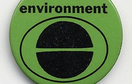Green button with black design and lettering