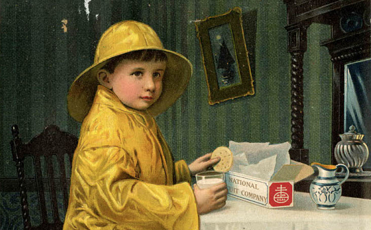 Boy eating crackers wearing yellow rain slicker and hat