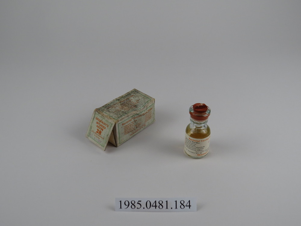 a vial and a box