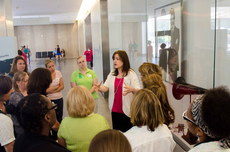 Image of group of Teach it Forward participants touring the Museum