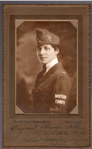Woman standing in profile, facing the camera, dressed in World War I uniform