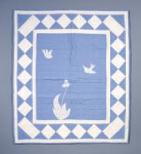 Blue flour sack bassinet quilt with white accent designs