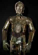 C-3PO from Return of the Jedi, standing with arms at its sides