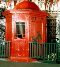 Yankee Stadium red ticket booth with black gates