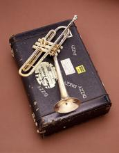 Dizzy Gillespie's brass trumpet with black carrying case