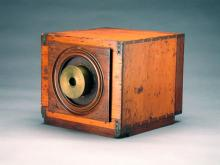 Early camera made of wood, metal and glass
