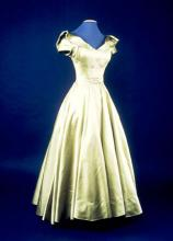 Image of a yellow and green silk gown worn by Hattie Carnegie