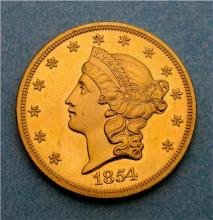 Gold coin with head of Liberty