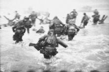 Black and white photograph depicting a scene from D Day
