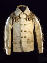 Double-breasted buckskin coat, with fringe on the pockets and collar and along the sleeves.