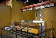 Greensboro Lunch Counter with salmon and sea-foam seats