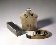 Doughboy bread tin, canteen and belt meant to hold military rations
