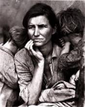 Black and white photograph of a mother and two children